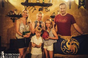 family with kids in Dubrovnik playing a Game of Thrones escape room