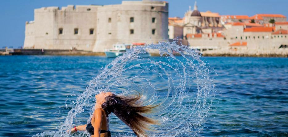 woman swimming when its too hot in Dubrovnik